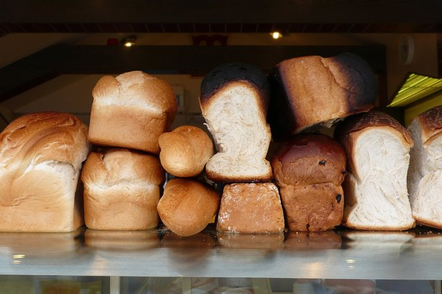 Loaves of fresh bread pilled high in a bakery.