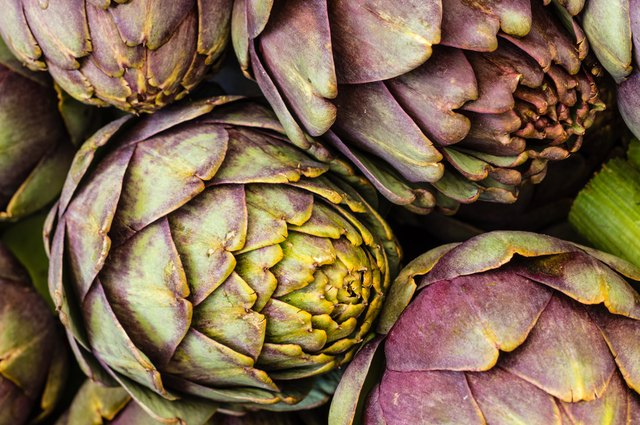 A close-up of freshly picked artichokes.