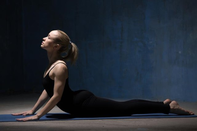 Stretch your whole front body with cobra pose.