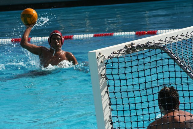 Player attempts to toss water polo ball at goal