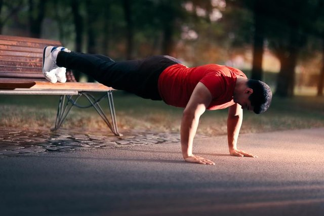 Doing push-ups at a decline intensifies muscle activation.