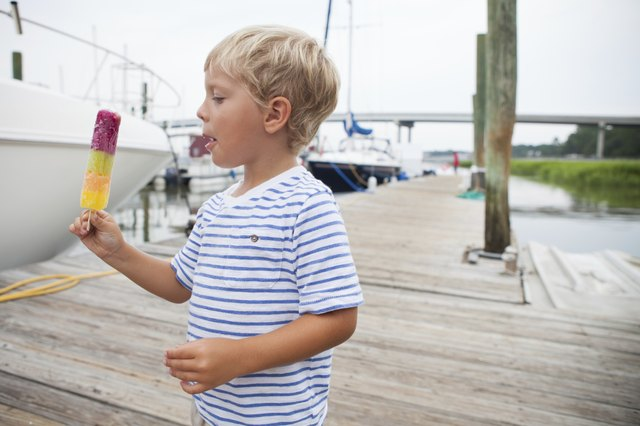 Young boy eating a popsicle