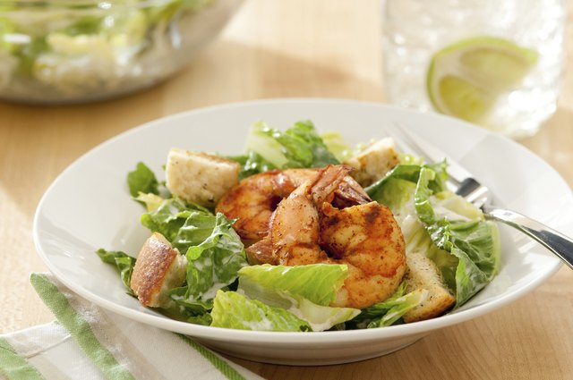 Keep protein in your diet by adding grilled shrimp to your salad.
