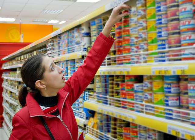 Woman shopping for canned foods