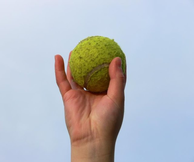 Use a tennis ball to treat shoulder spasms.