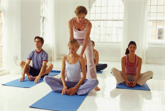 Proper posture both on the yoga mat and off helps alleviate pain.
