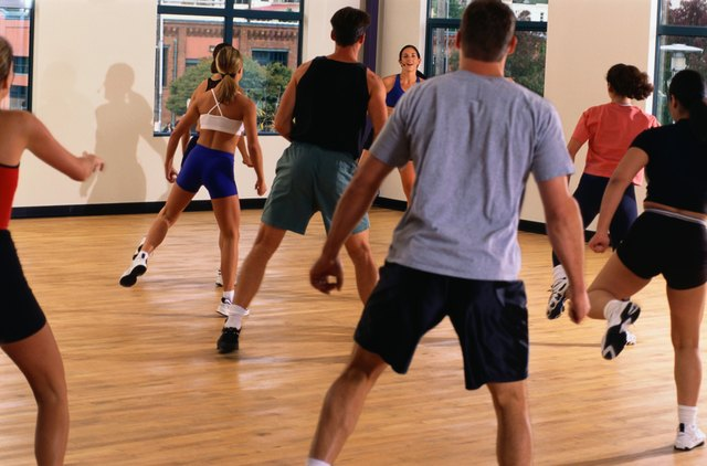 People participating in an aerobic work-out at the gym.