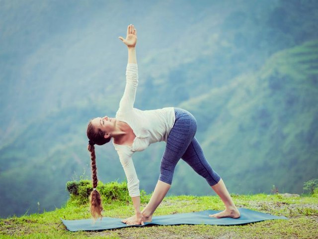 Triangle pose can be beneficial for scoliosis.