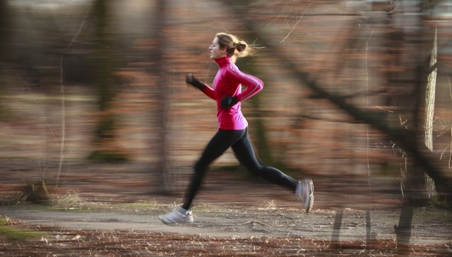Woman running outdoors on fall day