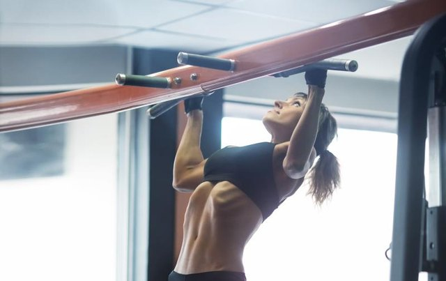 Pull-ups target the upper back.
