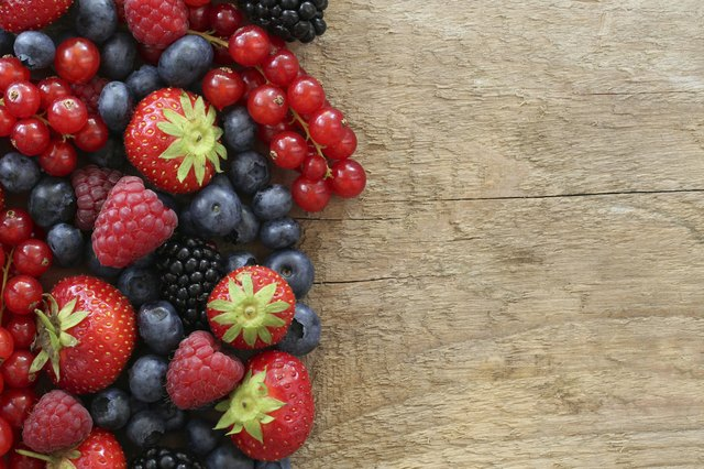 Assorted berries on wood