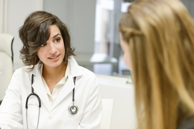 Young woman meets with her doctor