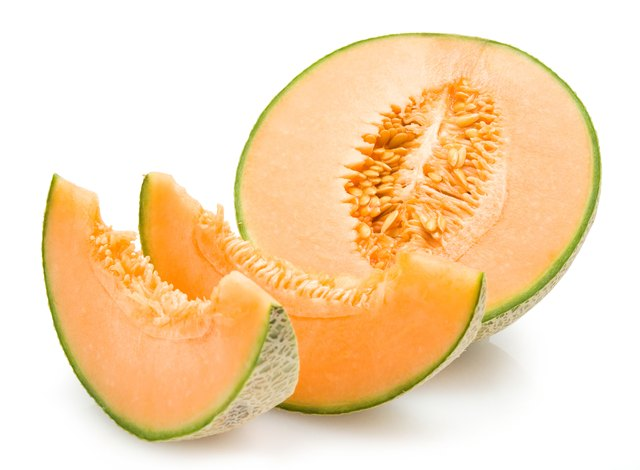Cut up cantaloupe melon.