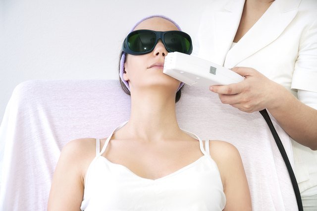 A woman receiving laser treatment.