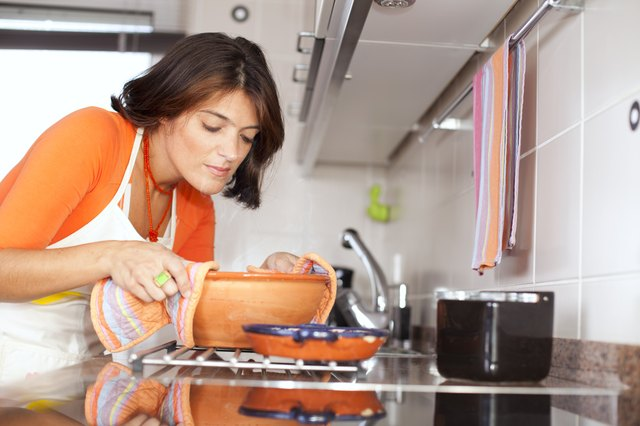 woman cooking on stovetop