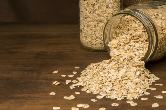 Oats spilling from a glass jar