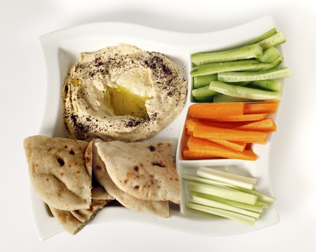 Hummus, vegetable sticks, and pita.