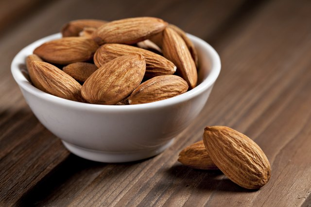 Almonds in a small white bowl