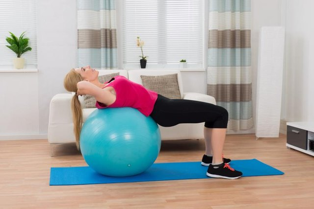 Increase the intensity of crunches with a ball.