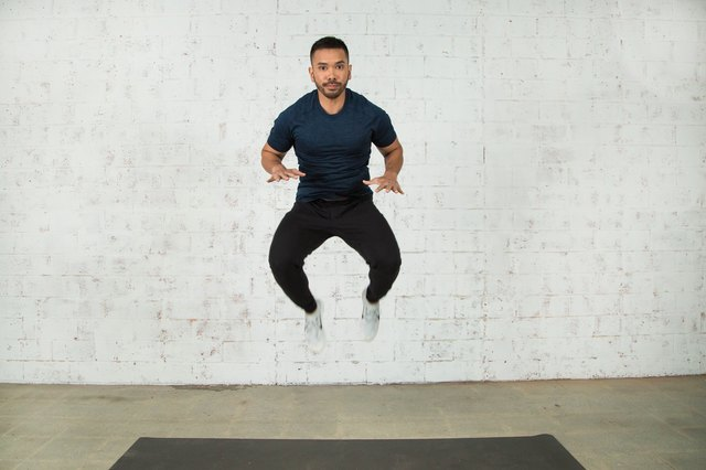 Spice up your burpees with a tuck jump.