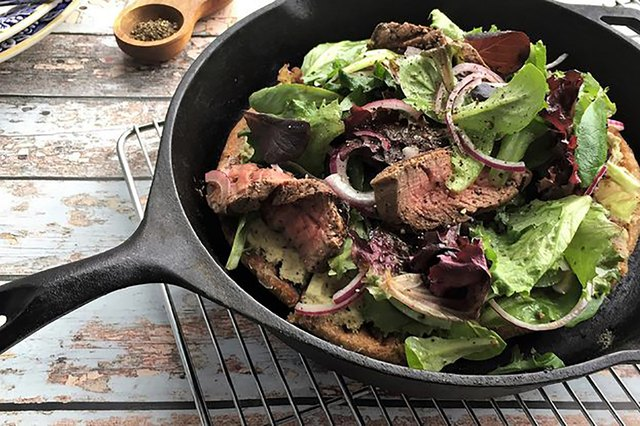 A salad served in a cast-iron skillet is too clever.