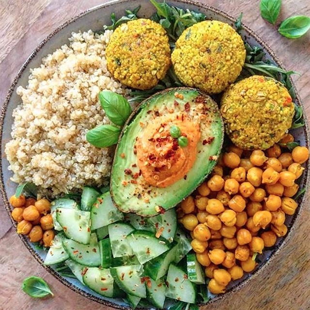Chickpea patties along with roasted chickpeas form the base of this hearty Mediterranean bowl.