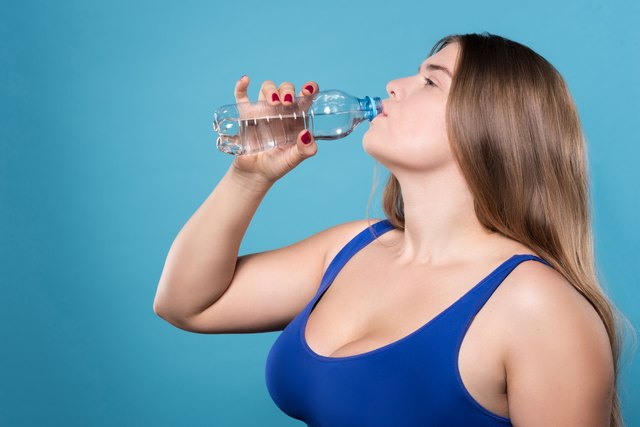 Rehydrate as necessary during a Zumba class.