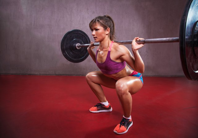 Barbell squats work the quads, hamstrings, and glutes at the same time.