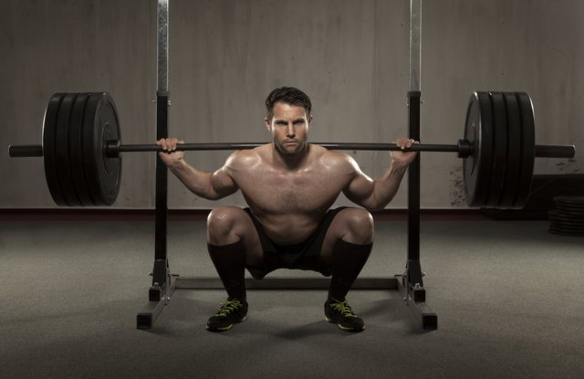 Load up the barbell and sink down into a squat.