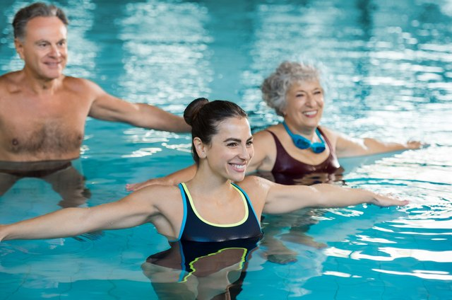 Performing jumping jacks in the water is a fantastic aerobic exercise.