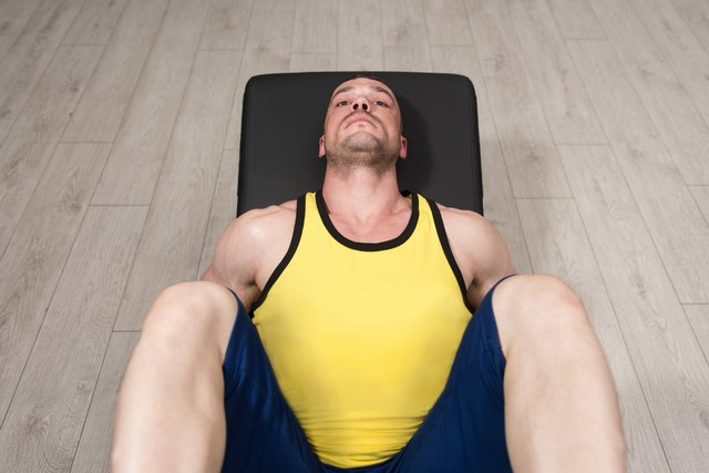 The vertical leg press is similar to the horizontal leg press, except your back should sit against the floor with your legs positioned straight up into the air.