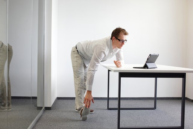 Stand up and stretch regularly to work your leg muscles.
