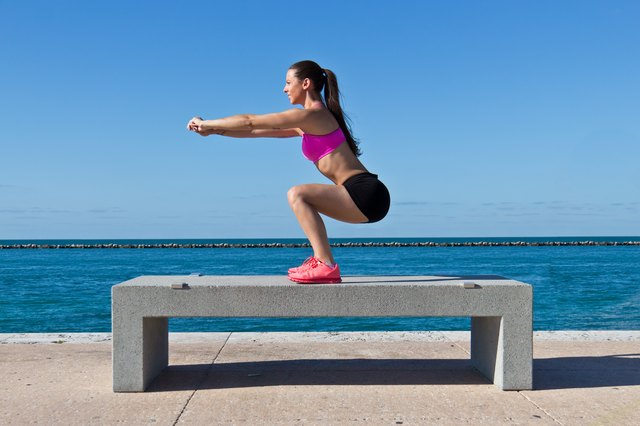 Squat using just your bodyweight or holding dumbbells to stimulate your quads.