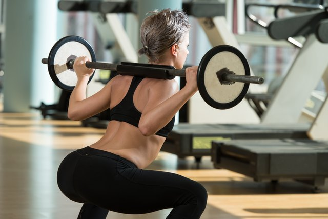 Add a barbell to your squats to increase the intensity.