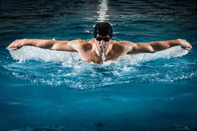 Does Swimming Build Pecs?