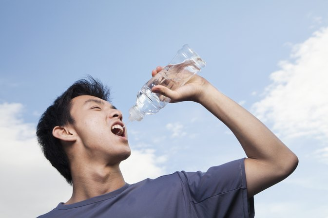Person Drinking Water From Bottle