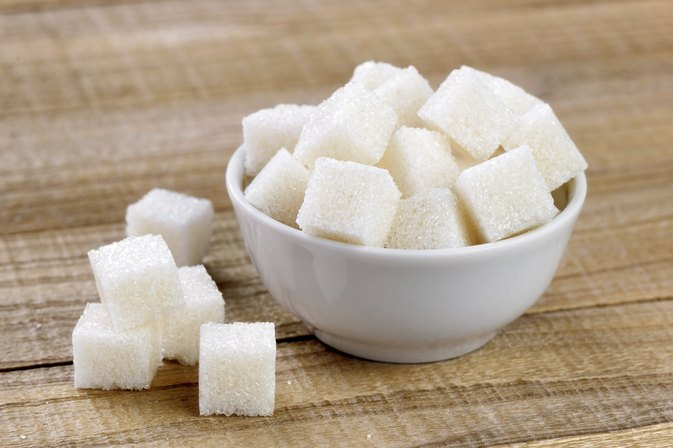 How Many Calories & Carbohydrates Are There in Sugar?