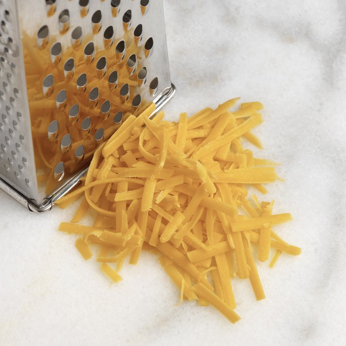 How Many Calories Are in 1/4 Cup of Shredded Cheddar Cheese?