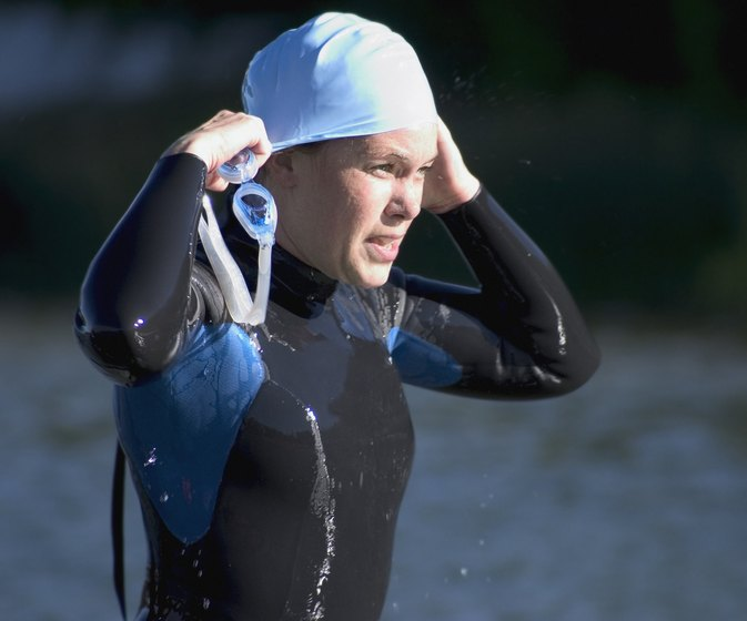 Why Do Swimmers Wear Caps?