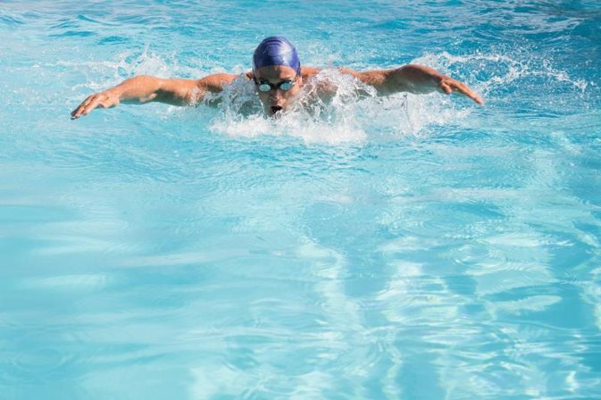 Writing arm movements in swimming