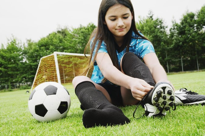 Difference Between Little League Baseball & Soccer Cleats