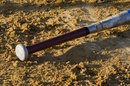 What Are College Baseball Bats Made Of?