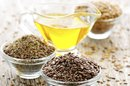 Can I Take Flaxseed Oil & Fish Oil Together?