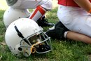 Difference Between Lineman Cleats & Running Back Cleats