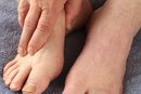 What Does It Mean When Your Big Toe Is Swollen & It Hurts on Top?