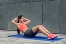How to Do Sit-Ups Without Anchoring Your Feet