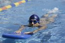 What Are the Benefits of Using a Kickboard When Swimming?