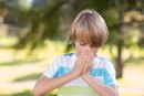 Sneezing, Running Nose & Light Sensitivity in a Child