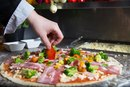 How Many Calories in Whole Wheat Crust Pizza With Vegetables?