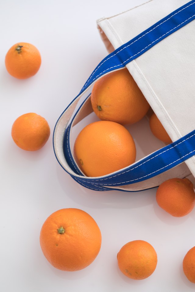 Oranges falling out of bag